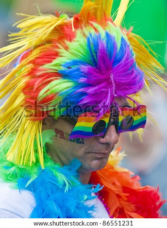 NEW YORK -  JUNE 26 : An unidentified participant celebrates in a gay pride parade after passing the same sex marriage bill in New York City on June 26 2011.