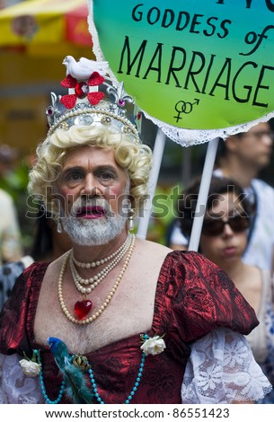 NEW YORK -  JUNE 26 : An unidentified participant celebrates in a gay pride parade after passing the same sex marriage bill in New York City on June 26, 2011. - stock photo