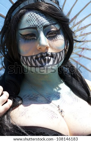 NEW YORK - JUNE 23:  An unidentified person participates in the 30th annual Mermaid parade on Coney Island in Brooklyn on June 23, 2012 in New York City, NY.