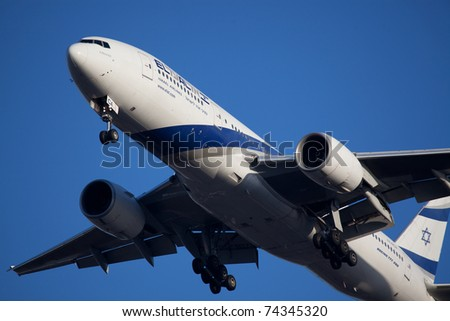 NEW YORK - JUNE 7: ELAL Boeing767 on approach to JFK in New York, USA on June 7, 2010. EL AL is rated the safest airline in the world is also flag carrier airline in Israel as of 2011 - stock photo