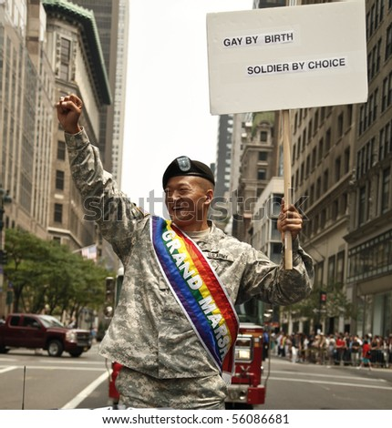 NEW YORK - JUNE 27: Grand Marshal Lieutenant Dan Choi leads at the 2010 New York City Gay Pride March on the streets of Manhattan on June 27, 2010 in New York City.