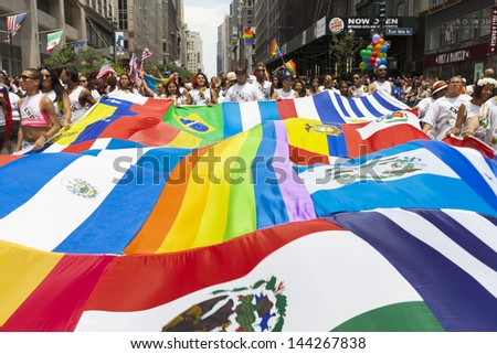 NEW YORK - JUNE 30: Latin American flags during annual 43rd Pride Parade on Fifth Avenue in Manhattan on June 30, 2013 in New York City