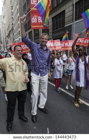 NEW YORK - JUNE 30: Mayor candidate Bill De Blasio attends annual 43rd Pride Parade on Fifth Avenue in Manhattan on June 30, 2013 in New York City