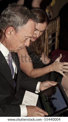 NEW YORK - JUNE 17: Mayor Michael Bloomberg checks iPad while attends Inside Broadway 2010 Beacon Awards at Players Club on June 17, 2010 in New York City.