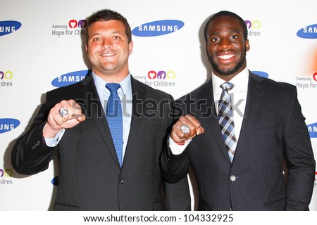 NEW YORK-JUNE 4: New York Giants players Henry Hynoski and Prince Amukamara attend Samsung's annual Hope for Children gala at the American Museum of Natural History on June 4, 2012 in New York City.