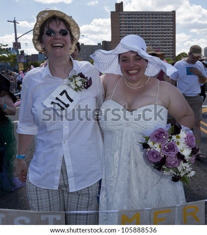 NEW YORK - JUNE 23: Newly married Windi and Starla Muraszka attend 30th annual Mermaid parade on Coney Island in Brooklyn on June 23, 2012 in New York City.