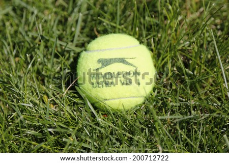 NEW YORK - JUNE 22  Slazenger Wimbledon Tennis Ball on grass tennis court on June, 22, 2014 in New York  Slazenger Wimbledon Tennis Ball exclusively used and endorsed by The Championships, Wimbledon