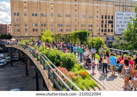NEW YORK - JUNE 15, 2013: The High Line Park in New York with locals and tourists. The High Line is a popular linear park built on the elevated train tracks above Tenth Ave in New York City