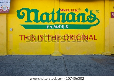 NEW YORK - JUNE 27: The Nathan's shop sign on June 27, 2012 in Coney Island, New York. Nathan's is a company chain of US restaurants specialized in hot dogs with 425 million Hot Dogs sold in 2011.
