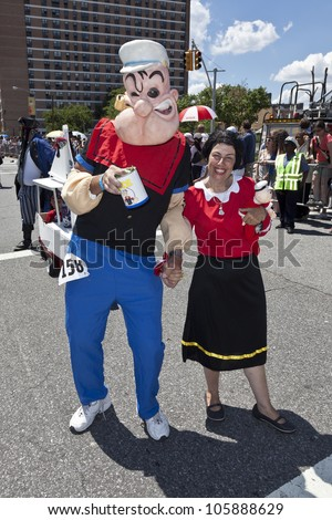 NEW YORK - JUNE 23: Unidentified participants as Popeye the Sailor and Olive Oyl attend 30th annual Mermaid parade on Coney Island in Brooklyn on June 23, 2012 in New York City.