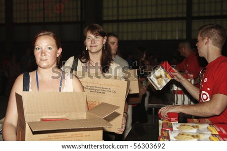 NEW YORK - JUNE 29: Unidentified volunteers help assemble meals at 'Target Party for Good' South Street on June 29, 2010 in New York City.
