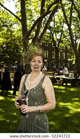 NEW YORK - JUNE 6: Woman in period clothing attends 5th Annual Jazz age concert and picnic on Governors Island on June 6 2009 in New York