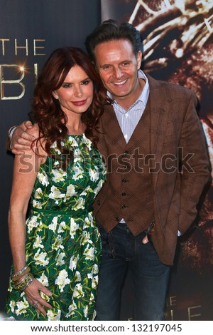 "NEW YORK-MAR 19: Actress Roma Downey and husband Mark Burnett attend the opening night gala of ""The Bible Experience"" on March 19, 2013 in New York City. - stock photo"
