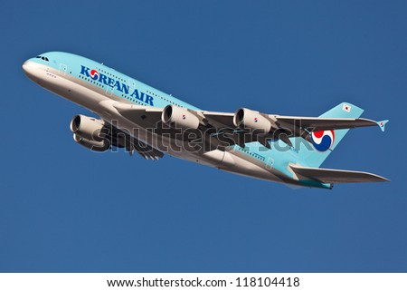 NEW YORK - MARCH 20:A380 Korean Air climbs after takeoff for JFK in New York, USA on March 20, 2012 Blue top livery was introduced on in 1984 A380 is the biggest passenger plane in the world