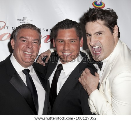 NEW YORK - MARCH 31: Alvis Duran (L), Rob Shooter (R) and guest attend the 26th annual Night Of A Thousand Gowns at the Marriott Marquis Times Square on March 31, 2012 in New York City