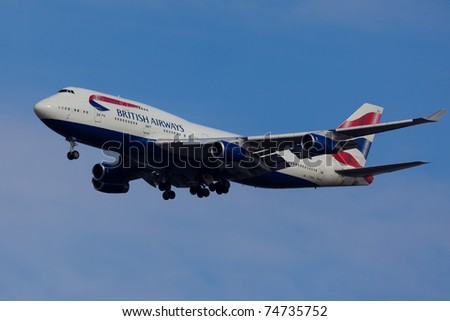 NEW YORK - MARCH 1: Boeing 747 British Airways approaching JFK in New York, USA on March 1, 2011. British Airways is one of the oldest airlines and rated top 3 biggest in Europe - stock photo