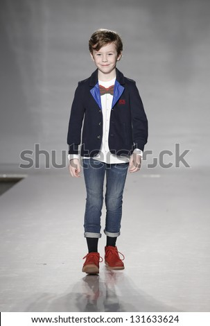 NEW YORK - MARCH 10: Boy model walks runway for petite Parade show by Iceberg during kids fashion week sponsored by Vogue Bambini at Industria Superstudio on March 10, 2013 in New York City