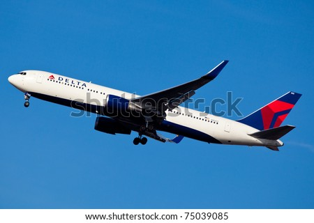 NEW YORK - MARCH 30: Delta Boeing 777 climbs after take off from JFK in New York, USA on March 30, 2011. Delta is one of the biggest airlines in the world, serve over 300 destinations around the world