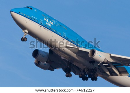 NEW YORK - MARCH 9: KLM Boeing 747 climbs after take off from JFK Airport located in New York, USA on March 9, 2011. KLM is one of the biggest airlines in the world serve for over 200 destinations