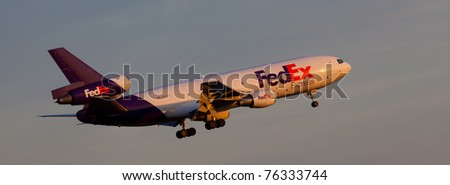 NEW YORK - MARCH 8:MD-10 approaching JFK Airport located in New York, USA on March 8, 2011. Fedex is the biggest shipping/cargo company in the world serve over 300 destinations worldwide