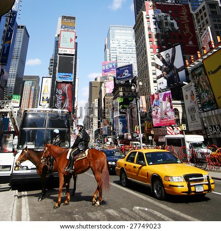 NEW YORK - MARCH 22: NY police maintain order at Times Square March 22, 2006 in New York, USA. Times Square has achieved the status of an iconic world landmark and has become a symbol of its city.