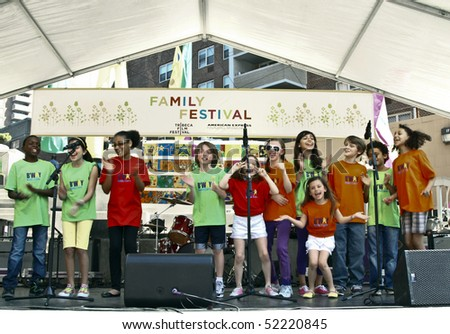 NEW YORK - MAY 01: A kids choir performs on the stage on Family Festival Street Fair during the 2010 Tribeca Film Festival on May 1, 2010 in NYC