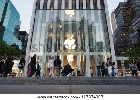 NEW YORK - MAY 14, 2015: Apple store entrance on 5th Avenue in Manhattan. As of 2014, Apple employs 72,800 permanent full-time employees, maintains 437 retail stores in fifteen countries.