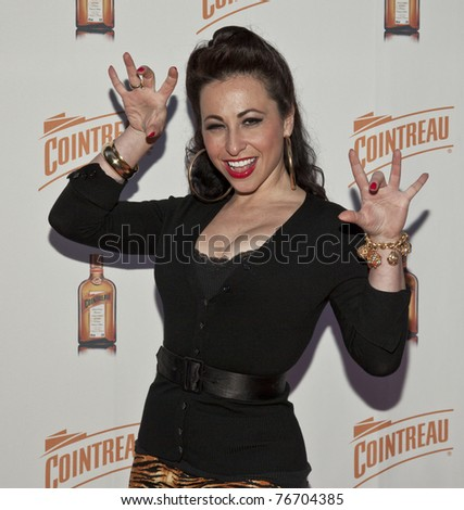 NEW YORK - MAY 05: Burlesque artist Angie Pontani attends launch of Dita Von Teese new signature cocktail 'The Cointreau MargaDita' at Los Feliz restaurant on May 05, 2011 in New York City, NY