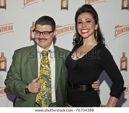 NEW YORK - MAY 05: Burlesque artists Murray Hill, Angie Pontini attend launch of Dita Von Teese new signature cocktail 'The Cointreau MargaDita' at Los Feliz restaurant on May 05, 2011 in New York City, NY