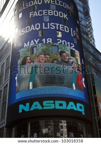 NEW YORK - MAY 18: Facebook CEO Mark Zukerberg is flashed on a screen outside the NASDAQ stock exchange at the opening bell in Times Square on May 18, 2012 in New York City. - stock photo