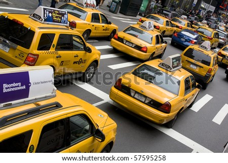 NEW YORK - MAY 28: Group of yellow taxi cabs rush tourists around Manhattan May 28, 2010 in New York City, NY
