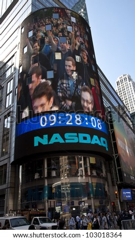 NEW YORK - MAY 18: Image of employees of Facebook is flashed on a screen outside the NASDAQ stock exchange at the opening bell in Times Square on May 18, 2012 in New York City. - stock photo