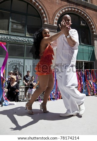 NEW YORK - MAY 21: Members of Flamenco New York dances on Broadway as part of New York Dance Parade on May 21, 2011 in New York City