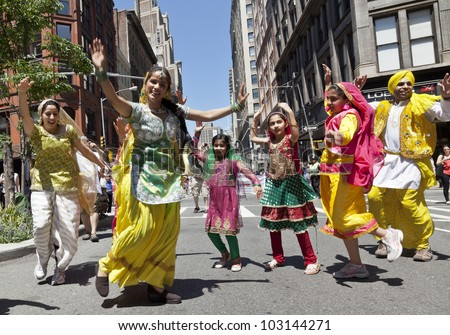 NEW YORK - MAY 19: Members of South Indian Bhangra dance group perform on Broadway as part of New York Dance Parade on May 19, 2012 in New York City