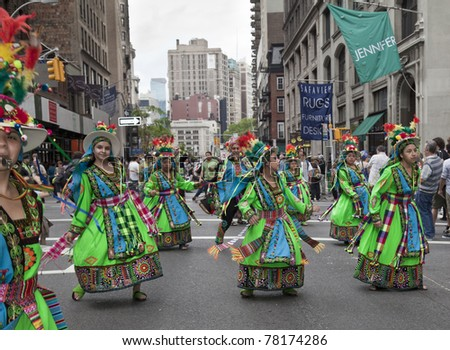 NEW YORK - MAY 21: Members of Tinkus Jacha dances on Broadway as part of New York Dance Parade on May 21, 2011 in New York City