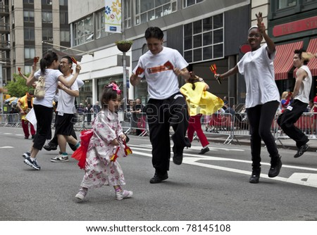 NEW YORK - MAY 21: Members of Yosakoi Dance Project - 10tecomai dances on Broadway as part of New York Dance Parade on May 21, 2011 in New York City