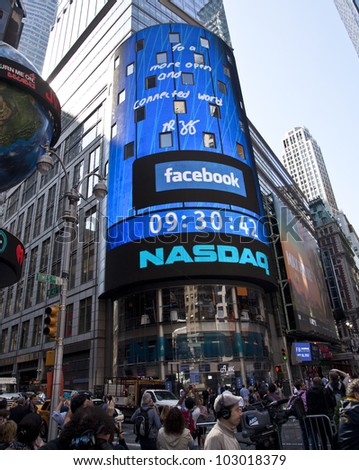 NEW YORK - MAY 18: Message signed by Facebook CEO Mark Zukerberg is flashed on a screen outside the NASDAQ stock exchange at the opening bell in Times Square on May 18, 2012 in New York City.