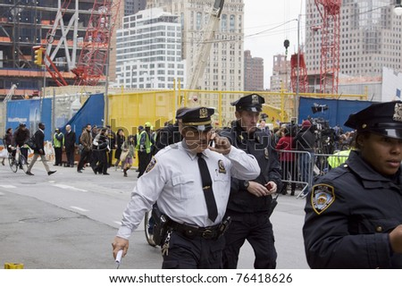 NEW YORK - MAY 2: NYPD officers walk near Trade Center PATH train station on May 2, 2011 in New York City. Osama bin Laden was killed in Pakistan by US Seals the day before.