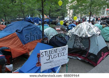 NEW YORK, N.Y. - OCTOBER 31 - Occupy Wall Street protesters' sign in front of the tent city at Zuccotti Park in the financial district, October 31, 2011, New York.
