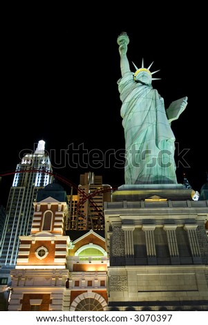 New York New York casino and replica of statue of Liberty on Las Vegas strip at night