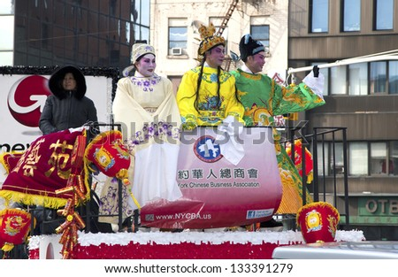 NEW YORK, NEW YORK - FEBRUARY 17: People wearing traditional Chinese costumes during Chinese New Year parade held in Chinatown.   Taken February 17, 2013 in NYC.