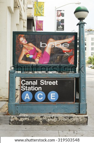 New York, New York, USA - June 20, 2011: A Canal Street subway station entrance with a Bebe poster on Canal Street in lower Manhattan. Tribeca Film Festival signs can be seen in the background.