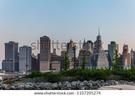 New York, New York / USA - 05 22 2018: New York city view, Manhattan from Brooklyn bridge park and street around #1107205274