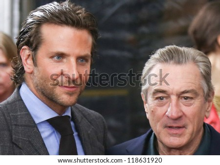 "NEW YORK-NOV 12: Actor Bradley Cooper (L) and Robert DeNiro attend the premiere of ""Silver Linings Playbook"" at the Ziegfeld Theatre on November 12, 2012 in New York City. - stock photo"