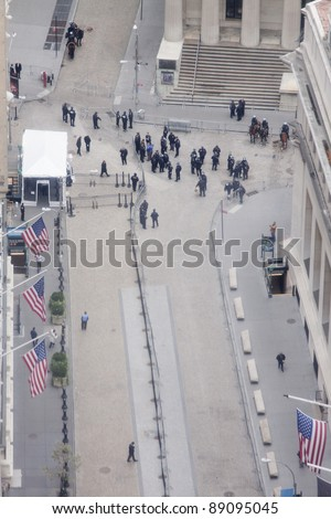 NEW YORK - NOV 17: Aerial view of Broad Street and entrance to the NY Stock Exchange on November 17, 2011 in New York City, NY. Police temporarily cleared the area after protesters impeded traffic.