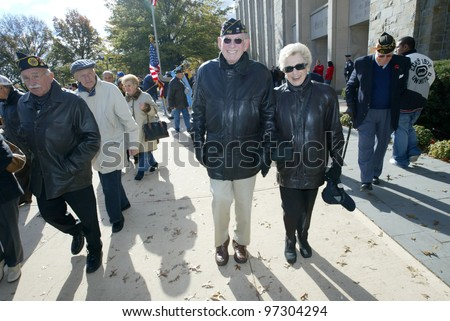 NEW YORK - NOV 11: Retired Judge and veteran Maurice Harbater (C) and his wife, Marilyn Harbater, attend the Veteran's Day Memorial service at St. John's University November 11, 2005 in Queens, NY.