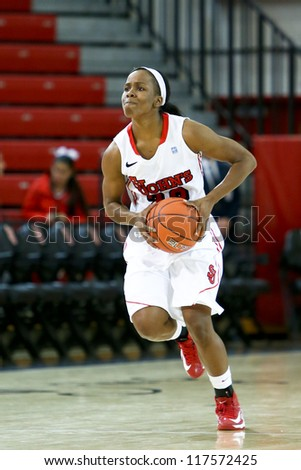 NEW YORK-NOV 3: St. John's Red Storm guard Eugeneia McPherson (22) looks to pass the ball against the Farmingdale Rams at Carnesecca Arena on November 3, 2012 in Jamaica, Queens, New York.
