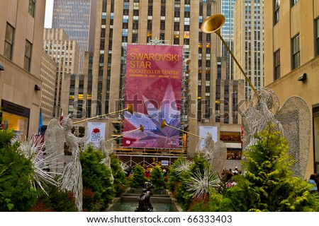 NEW YORK - NOV 27: The Rockefeller center started to show his annual famous Christmas decoration displays, people enjoy the ice skating rink and buy Christmas gifts, on November 27, 2010, in New York.