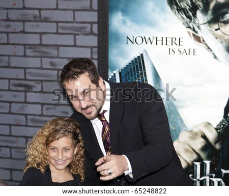 NEW YORK - NOVEMBER 15: Actor/Singer Joey Fatone and daughter Briahna Fatone attend the premiere of 'Harry Potter and the Deathly Hallows: Part 1' at Alice Tully Hall on November 15, 2010 in NYC