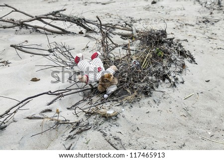 NEW YORK - NOVEMBER 1, 2012: An abandoned Teddy Bear on the sand of Brighton Beach after Hurricane Sandy in Brooklyn area on November 1, 2012, Brooklyn, NY